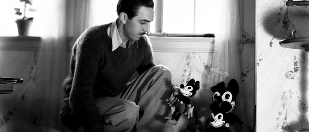 Walt Disney toys around with a group of Mickey plush dolls, circa 1935. ©Disney